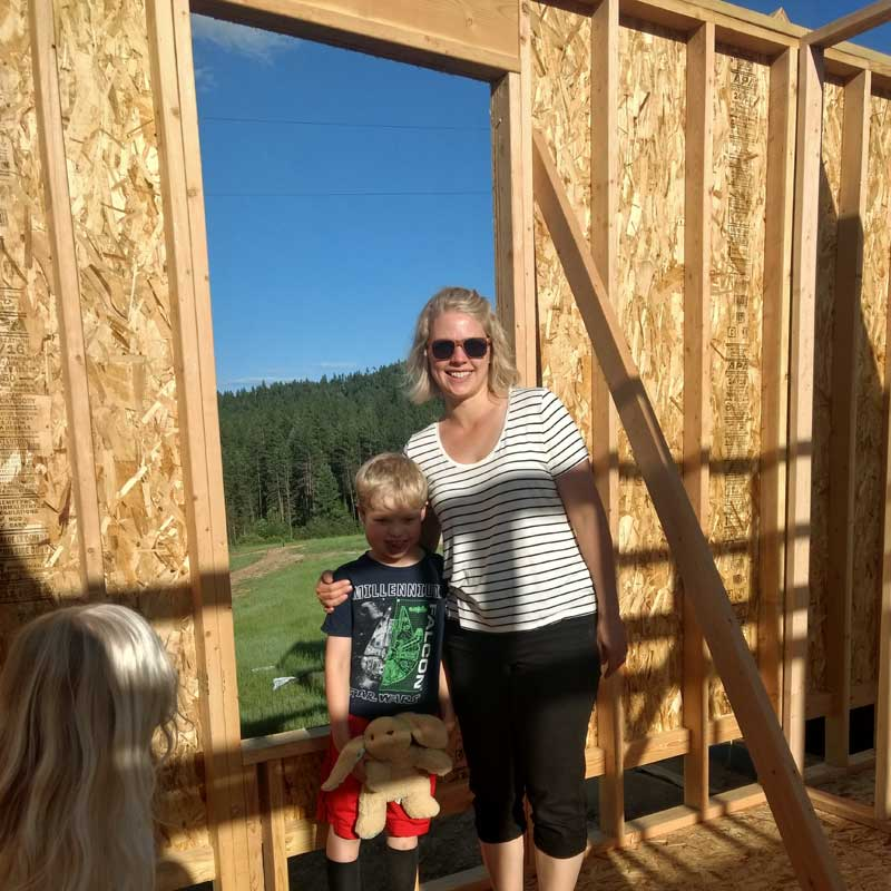 Financial health coach, Shannon Clark, checking out the construction of her family's dream home with her kids.